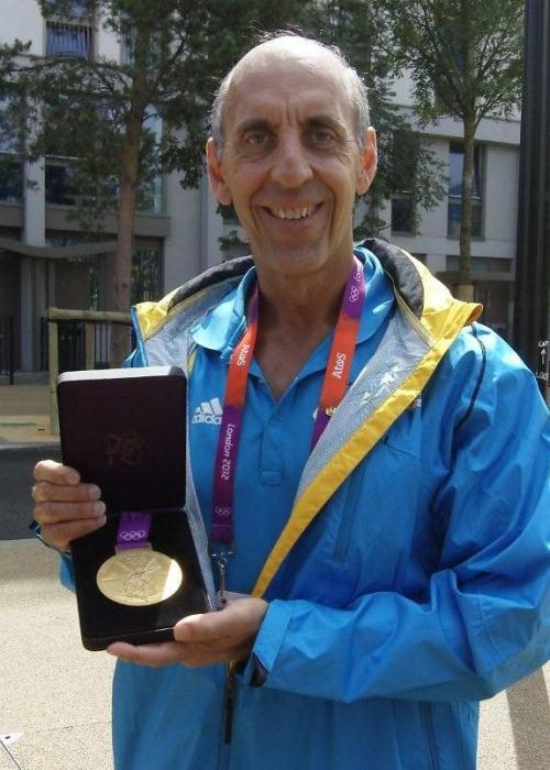 Dr. Claussen displays a gold medal from his Bahama's team win at the 2012 London Olympics.