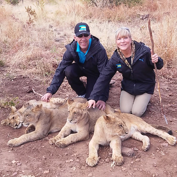 Taming the lions in Botswana, Africa, while attending the World Relays 2017.